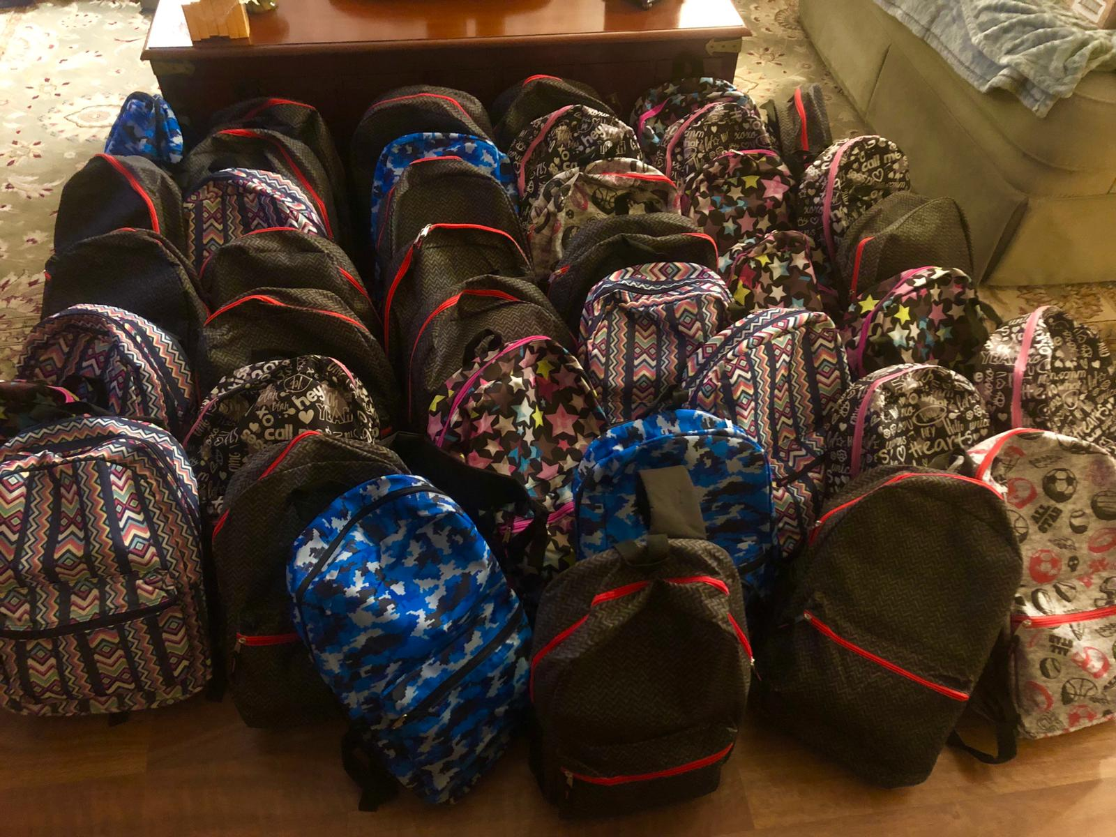 OCRA Donates Backpacks
